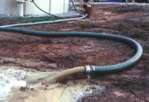 Sediment Being Removed from a Ground Storage Tank